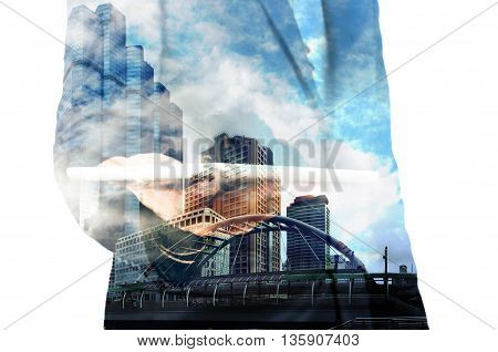 Double Exposure Of Businessman With Tablet And Modern City Building