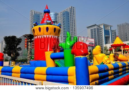 Chengdu China - October 7. 2013: Magical kingdom inflated children's play area at the Long Tan Water Village