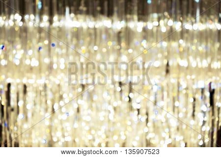 Blurred image of big beautiful chandelier with dark lighting.