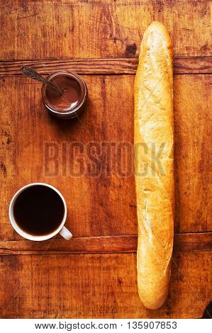 French bread and chocolate on wooden table