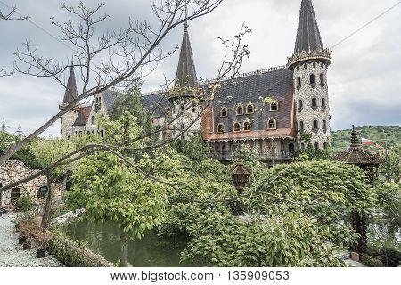 BURGAS, RAVADINOVO, BULGARIA - MAY 4: Walls of the castle and flower garden, on May 4, 2016 in Burgas, Ravadinovo, Bulgaria.