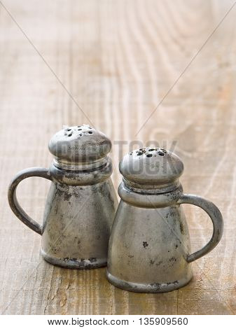 close up of rustic salt and pepper shaker