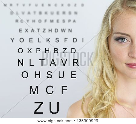 young woman with a table of optical correction over a white background
