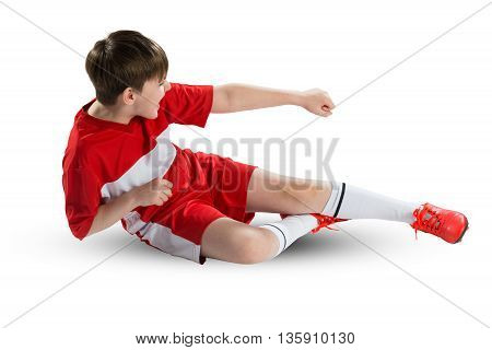 Boy football player in red uniform against white background