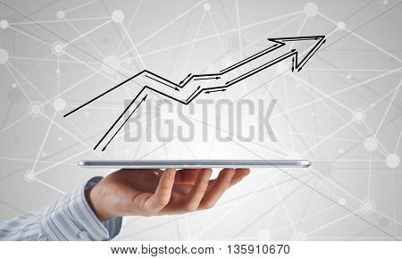 Close view of businessman holding tablet presenting growth concept