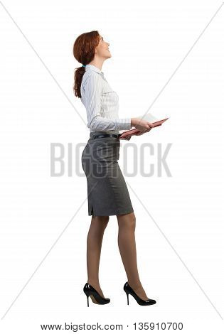 Young businesswoman on white background with red book in hands
