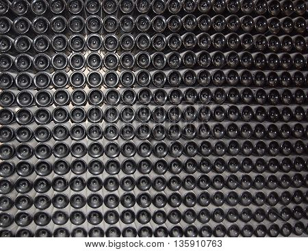 Wine bottles maturing. Wine bottles in a rack abstract background.