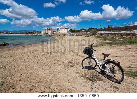 Bicycle Parked On Sandy Beach
