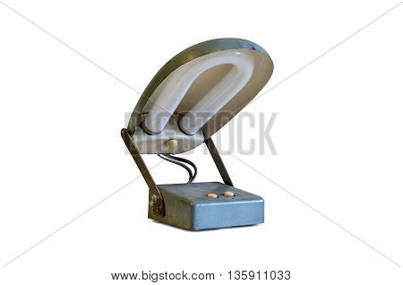 Old metal table-lamp isolated on white background.