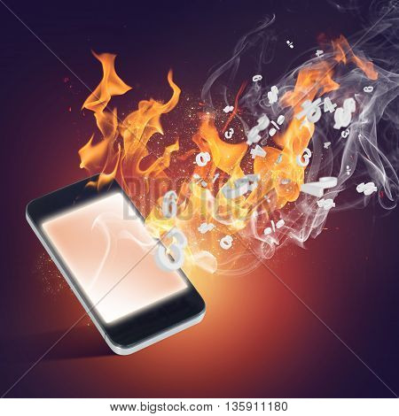 Conceptual image with mobile phone burning in flames
