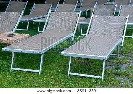 beautiful beach chairs with umbrella and small table