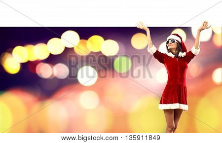 Attractive Santa woman with white blank banner. Place your text