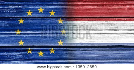 Image relative to politic relationships between European Union and Netherlands. National flags textured by wood
