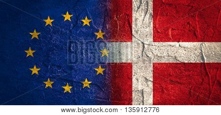 Image relative to politic relationships between European Union and Denmark. National flags textured by concrete