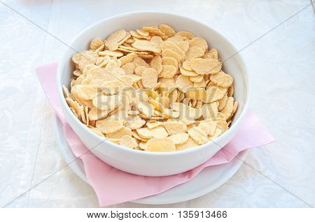 fantastic porcelain bowls filled with corn flakes cereal