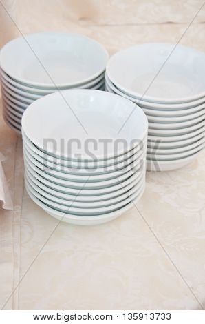 white dishes on a table ready for breakfast