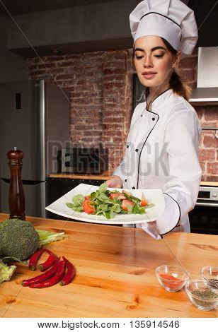 Woman Cook With Fresh Salad In Her Hands
