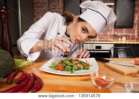 Woman Cook Preparing Fresh Salad With Tomatoes In Kitchen