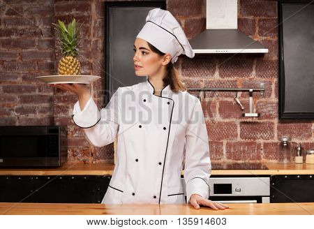 Woman Cook With Pineapple On The Plate