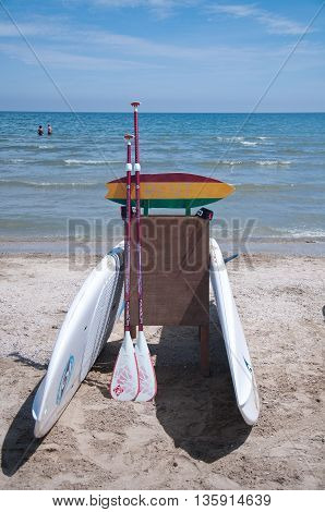 7 june 2016-riccione-italy-surfboard used as a sign for bicycle rent