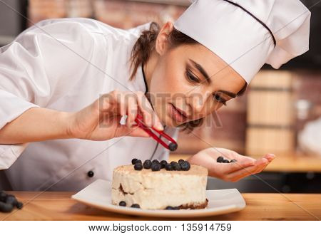 Female Chef Cook Preparing A Sweet Cake In The Kitchen. .