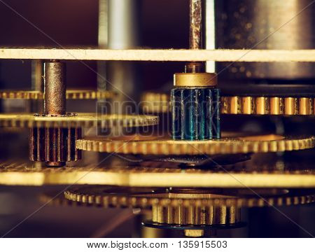 Retro gold gear wheels of a clockwork