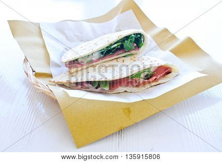 Cool and delicious piadine with ham cheese and vegetables squaccheroneitaly