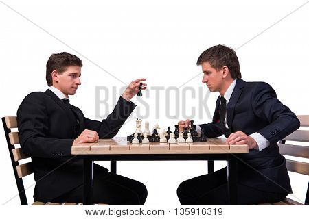Twin brothers playing chess isolated on white