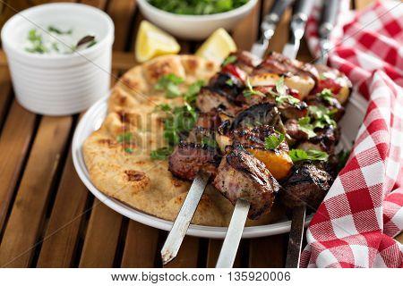 Lamb kebabs with flatbread, lemon and tzatziki sauce