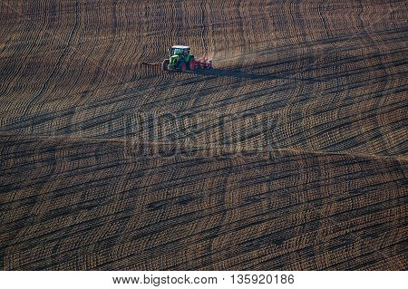 Farm Tractor Handles Earth On Field