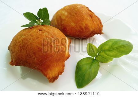 Meat pie pirog russian pastry on white plate