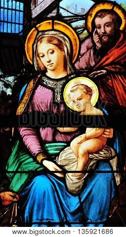 Triel sur Seine France - april 3 2016 : Mary and Jesus on historical stained glass window in Saint Martin church
