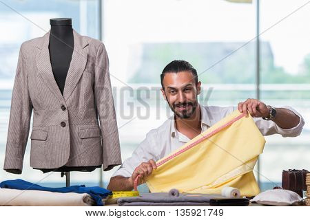 Young tailor working on new clothing design
