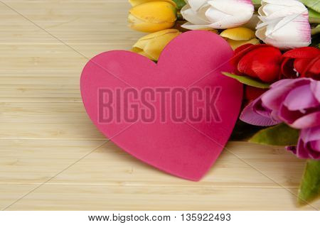 Tulips flowers arranged with copyspace for your text