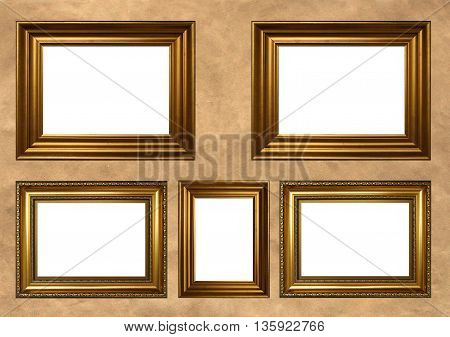 Five antique golden frames with white copy space on vintage background
