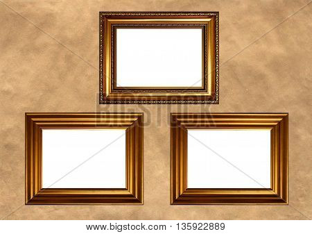 Three antique golden frames with white copy space on vintage background