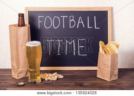 Football Fans Setting Of Beer Bottle In Brown Paper Bag,  Glass, Chips, Pistachio And Handwriting Te