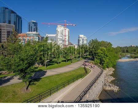 CALGARY, CANADA - JUNE 5: Joggers on a river path in downtown on June 5, 2016 in Calgary, Alberta Canada. The river paths downtown are popular among joggers and walkers during the summer months.