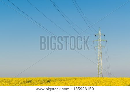 High voltage power line on a blue sky background