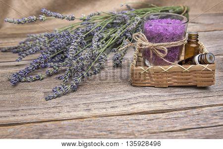 Lavender and sea salt on wooden boards. Still life.