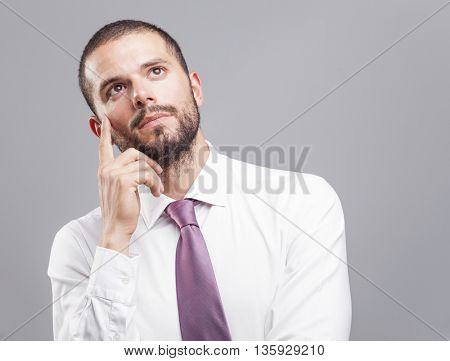 Portrait of a thoughtful young business man
