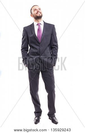 Thinking young businessman standing on white background