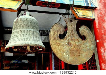 Dan Jing Shan China - March 16 2009: Temple bell and drum each inscribed with Chinese characters at the Fo Shan Gu Si Temple