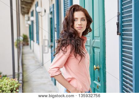 woman with  against sunny italian house