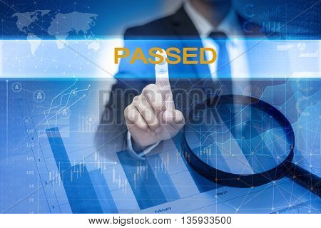 Businessman hand touching PASSED button on virtual screen