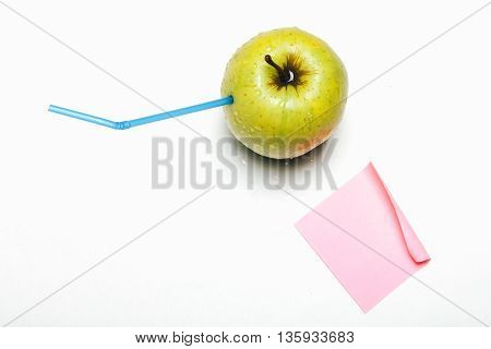 Green Apple With Straw Isolated On White