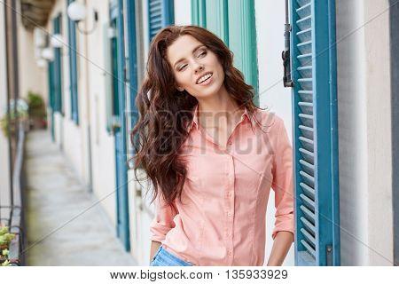 woman with  against sunny italian house