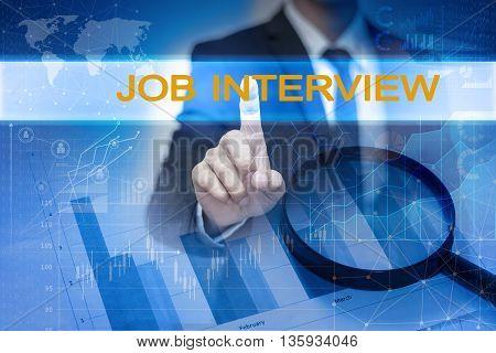 Businessman hand touching JOB INTERVIEW button on virtual screen