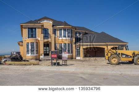CALGARY, CANADA - JUNE 5: Large estate home under construction on June 5, 2016 in Calgary, Alberta. Calgary's recent estate home construction growth has slowed due to oil prices.