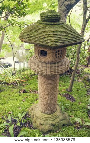 Japanese stone lantern on the mossy forest